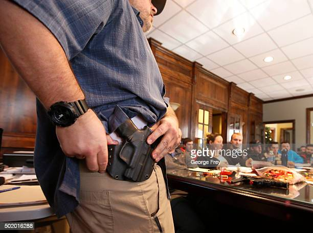 Damon Thueson shows a holster at a gun concealed carry permit class put on by 'USA Firearms Training' on December 19 2015 in Provo Utah Demand for...