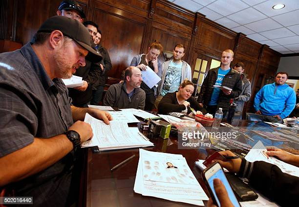 Damon Thueson signs final paperwork at a gun concealed carry permit class put on by USA Firearms Training on December 19 2015 in Provo Utah Demand...