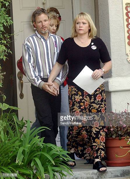 Damon van Dam and his wife Brenda walk out of their house to speak at a press conference February 26 2002 in the Sabre Springs section of San Diego...