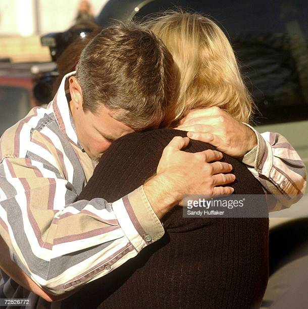 Damon van Dam embraces his wife Brenda during a press conference at their home February 26 2002 in the Sabre Springs section of San Diego CA The van...
