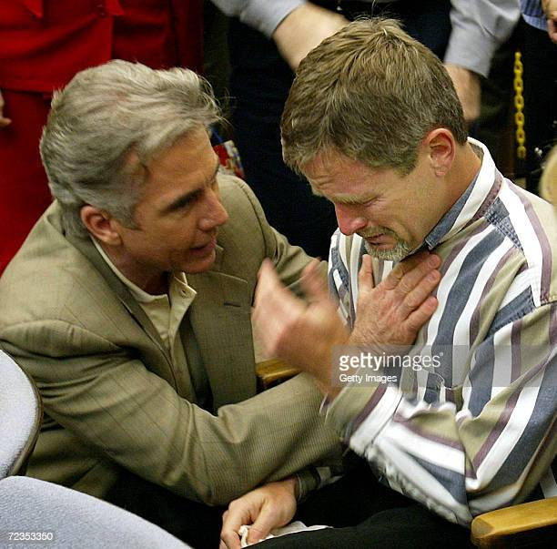 Damon van Dam father of missing 7yearold Danielle van Dam is consoled by Americas Most Wanted host John Walsh in a San Diego Superior Courtroom...