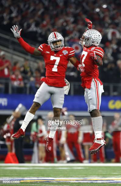 Damon Webb and Jerome Baker of the Ohio State Buckeyes celebrate after Baker recovered a fumble in the first half of the 82nd Goodyear Cotton Bowl...