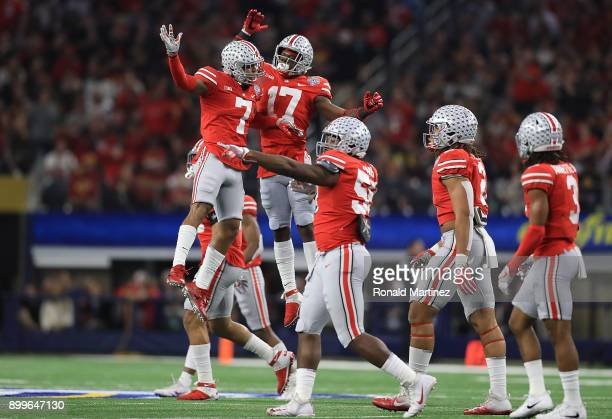 Damon Webb and Jerome Baker of the Ohio State Buckeyes celebrate a fumble recovery against the USC Trojans in the second quarter during the Goodyear...