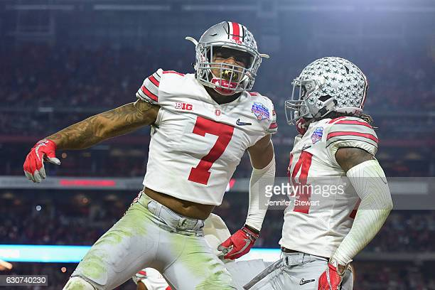 Damon Webb of the Ohio State Buckeyes and Malik Hooker react during the first half of the 2016 PlayStation Fiesta Bowl against the Clemson Tigers at...