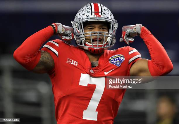 Damon Webb of the Ohio State Buckeyes celebrates his touchdown pass interception against the USC Trojans in the second quarter during the Goodyear...