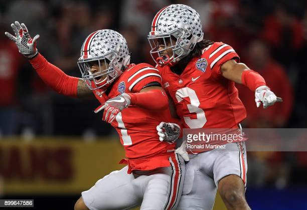 Damon Webb of the Ohio State Buckeyes celebrates his touchdown pass interception with Damon Arnette against the USC Trojans in the second quarter...
