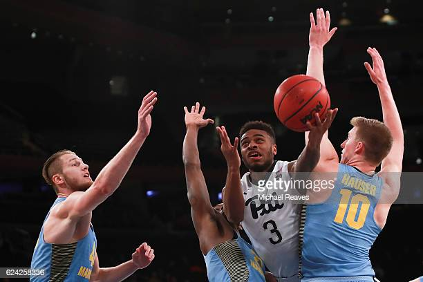 Damon Wilson of the Pittsburgh Panthers puts up a shot between the Marquette Golden Eagles defense in the second half of the 2K Classic at Madison...