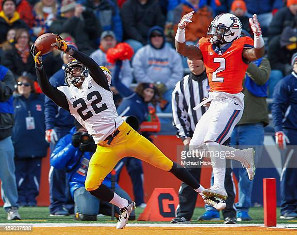 Damond Powell of the Iowa Hawkeyes makes a touchdown reception as V'Angelo Bentley of the Illinois Fighting Illini defends at Memorial Stadium on...