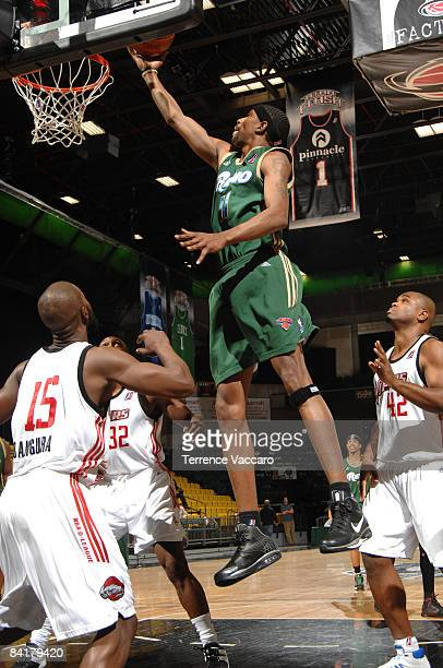 Damone Brown of the Reno Bighorns finds a clear shot over Alpha Bangura Joey Dorsey and Alton Ford of the Rio Grande Valley Vipers at McKay Events...