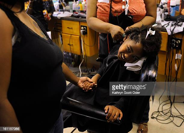Damonjaznae Armstrong gets a special hairstyle from stylist Nora Fruge whil mom Darlisa Navarro stand by to hold her daughter's hand This is the...