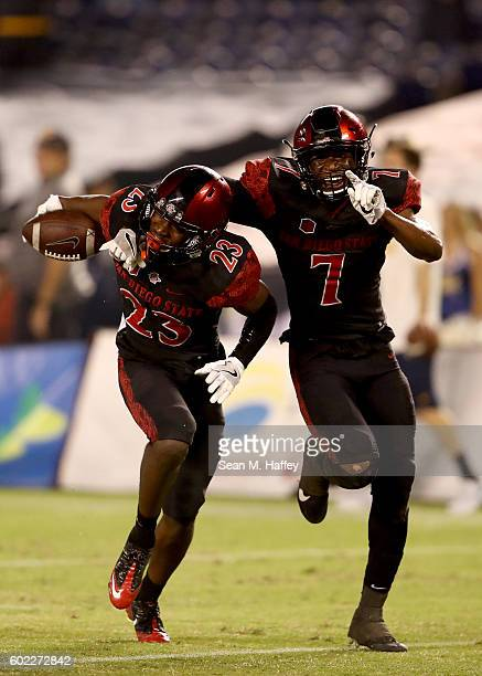 Damontae Kazee and Kameron Kelly of the San Diego State Aztecs react to intercepting a pass during the fourth quarter of a game against the...