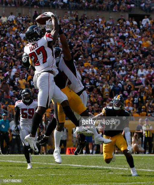 Damontae Kazee of the Atlanta Falcons intercepts a pass intended for Antonio Brown of the Pittsburgh Steelers in the end zone during the first half...