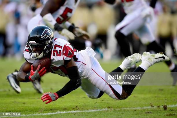 Damontae Kazee of the Atlanta Falcons makes an interception during the fourth quarter during their game against the Carolina Panthers at Bank of...