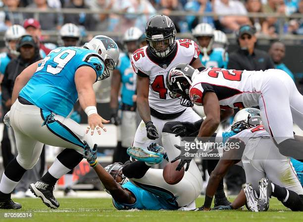 Damontae Kazee of the Atlanta Falcons recovers a fumble by Jonathan Stewart of the Carolina Panthers during their game at Bank of America Stadium on...