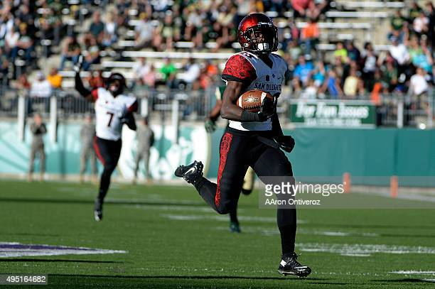 Damontae Kazee of the San Diego State Aztecs returns a picksix off of Nick Stevens of the Colorado State Rams during the third quarter of play The...