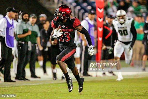 Damontae Kazee of the San Diego State Aztecs runs with the ball after intercepting a pass scoring a touchdown in the second half against the Hawaii...