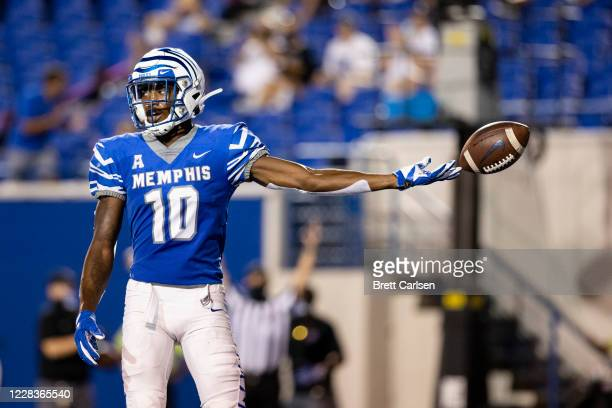 Damonte Coxie of the Memphis Tigers drops the ball in celebration after a third down touchdown pass reception against the Arkansas State Red Wolves...