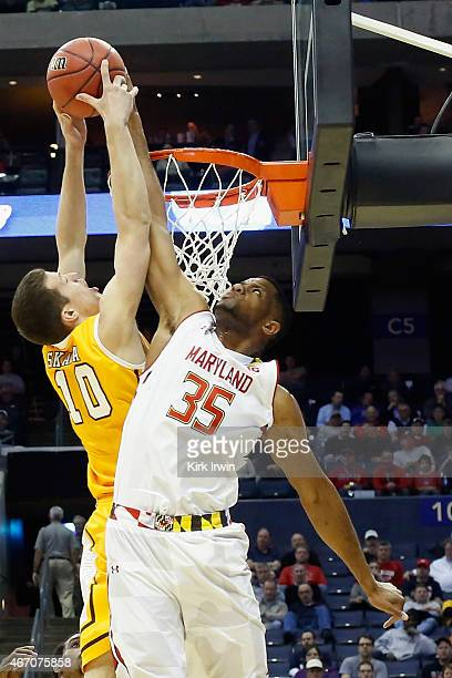 Damonte Dodd of the Maryland Terrapins jumps to block a shot by David Skara of the Valparaiso Crusaders during the second round of the Men's NCAA...