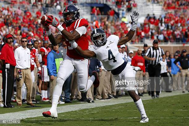Damore'ea Stringfellow of the Mississippi Rebels catches the ball over Monquavion Brinson of the Georgia Southern Eagles during the first half of a...