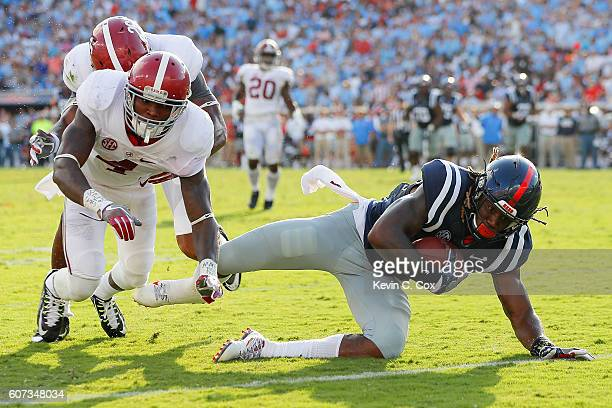Damore'ea Stringfellow of the Mississippi Rebels is tackled at the one yard line by Eddie Jackson and Marlon Humphrey of the Alabama Crimson Tide at...