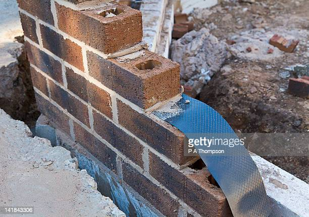 damp proof membrane being built into a brick wall house extension pr - membrane stock photos and pictures
