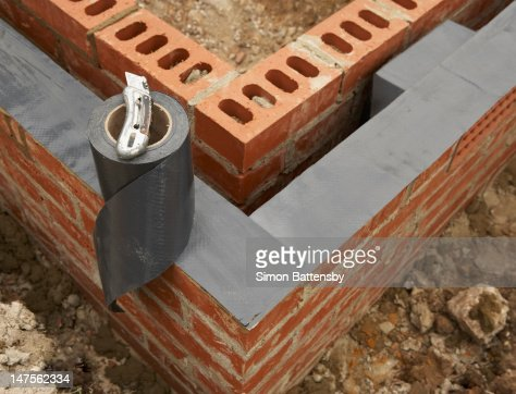 damp proof membrane on top of foundation walls stock photo. Black Bedroom Furniture Sets. Home Design Ideas