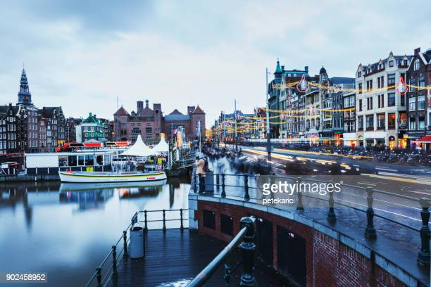 damrak avenue in amsterdam - netherlands stock pictures, royalty-free photos & images