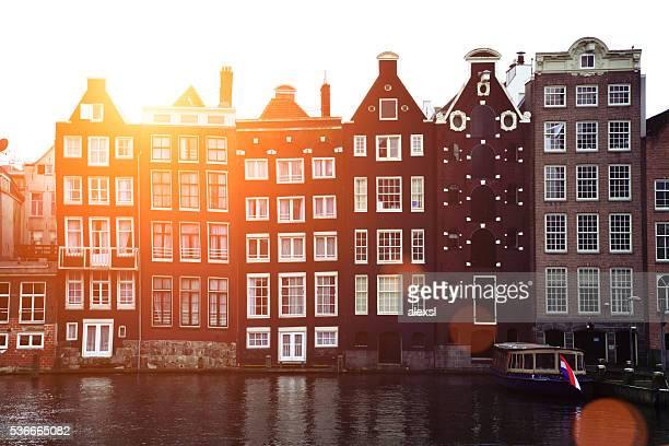 Damrak canal sunset in Amsterdam, Netherlands