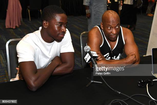 Damson Idris and John Singleton attend the 2017 ESSENCE Festival presented by CocaCola at Ernest N Morial Convention Center on July 1 2017 in New...