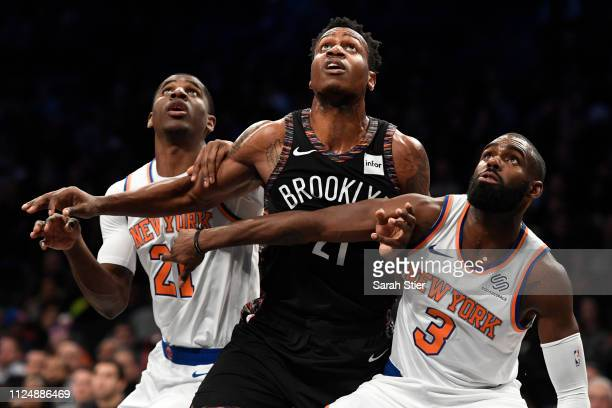 Damyean Dotson and Tim Hardaway Jr #3 of the New York Knicks guard Treveon Graham of the Brooklyn Nets during the second quarter of the game at...