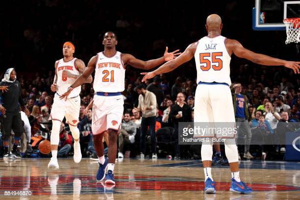 Damyean Dotson exchanges high fives with his teammate Jarrett Jack of the New York Knicks during the game against the Orlando Magic on December 3...