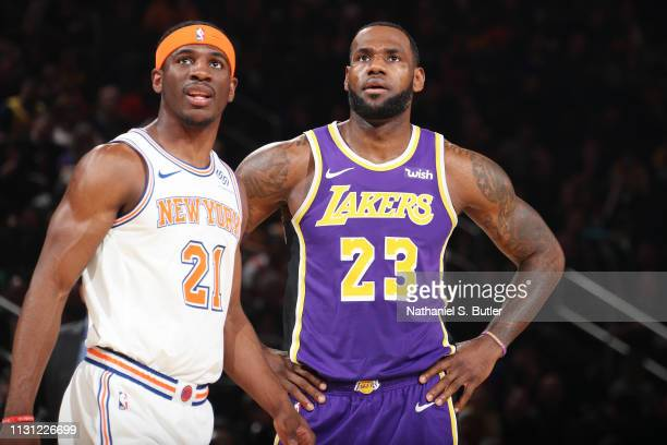 Damyean Dotson of the New York Knicks and LeBron James of the Los Angeles Lakers look on during the game on March 17 2019 at Madison Square Garden in...