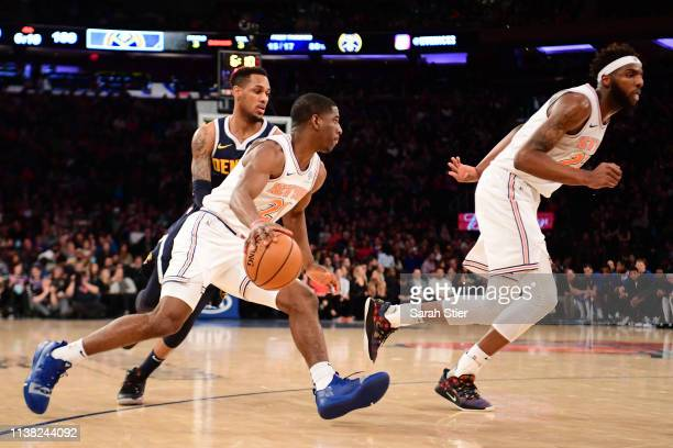 Damyean Dotson of the New York Knicks dribbles the ball during the second half of the game against the Denver Nuggets at Madison Square Garden on...