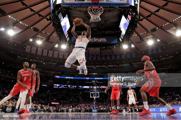Damyean Dotson of the New York Knicks drives to the basket against the Houston Rockets during the preseason game on October 9 2017 at Madison Square...