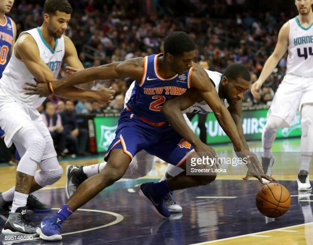 Damyean Dotson of the New York Knicks goes after a loose ball against Michael KiddGilchrist of the Charlotte Hornets during their game at Spectrum...