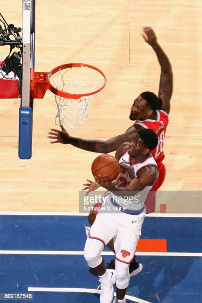 Damyean Dotson of the New York Knicks goes to the basket against the Houston Rockets on November 1 2017 at Madison Square Garden in New York City New...