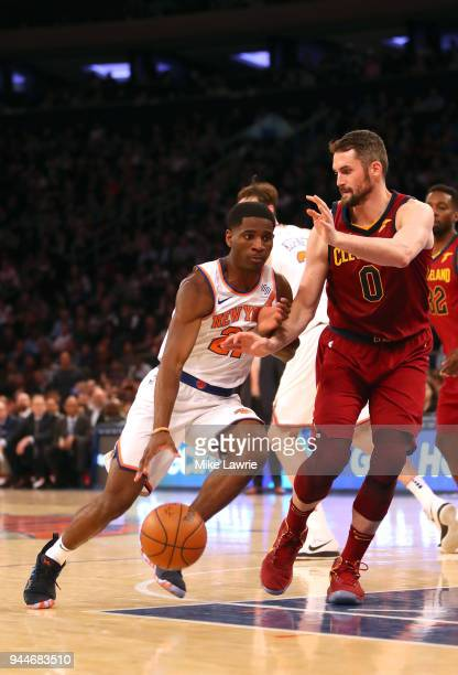 Damyean Dotson of the New York Knicks handles the ball against Kevin Love of the Cleveland Cavaliers in the fourth quarter at Madison Square Garden...