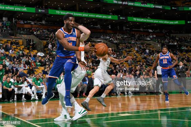 Damyean Dotson of the New York Knicks passes the ball during the game against the Boston Celtics on January 31 2018 at the TD Garden in Boston...