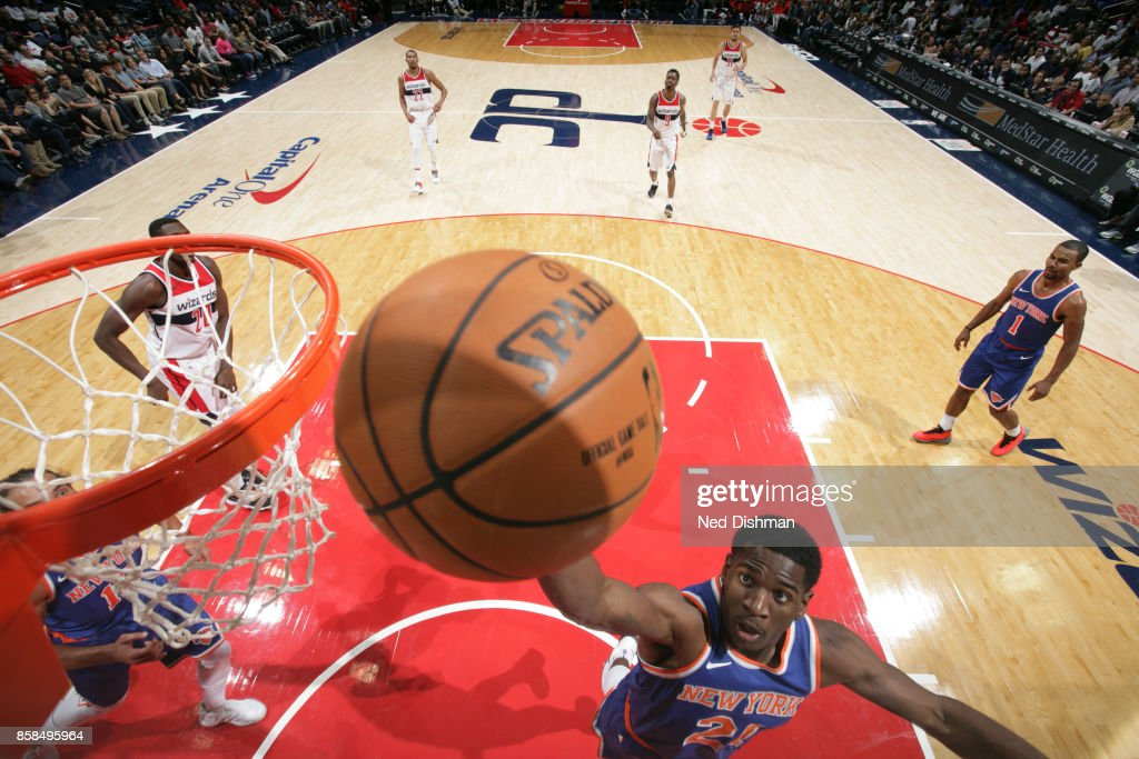 Damyean Dotson #21 of the New York Knicks shoots the ball against the Washington Wizards during the preseason game on October 6, 2017 at Capital One Arena in Washington, DC.