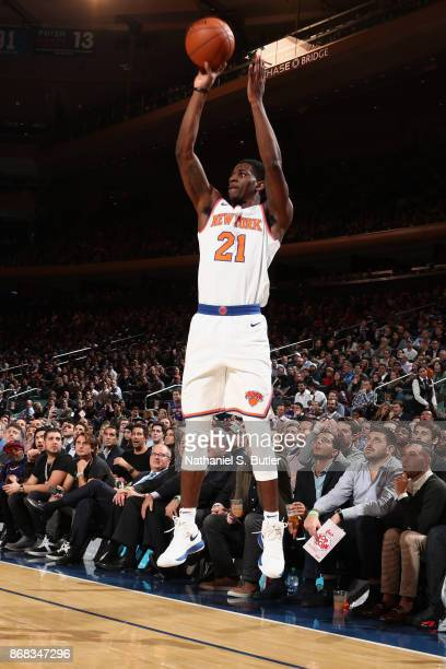 Damyean Dotson of the New York Knicks shoots the ball against the Denver Nuggets on October 30 2017 at Madison Square Garden in New York City New...