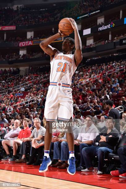 Damyean Dotson of the New York Knicks shoots the ball against the Houston Rockets on November 25 2017 at the Toyota Center in Houston Texas NOTE TO...