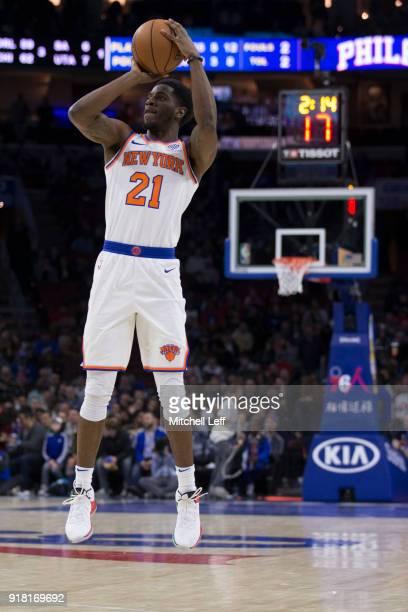 Damyean Dotson of the New York Knicks shoots the ball against the Philadelphia 76ers at the Wells Fargo Center on February 12 2018 in Philadelphia...