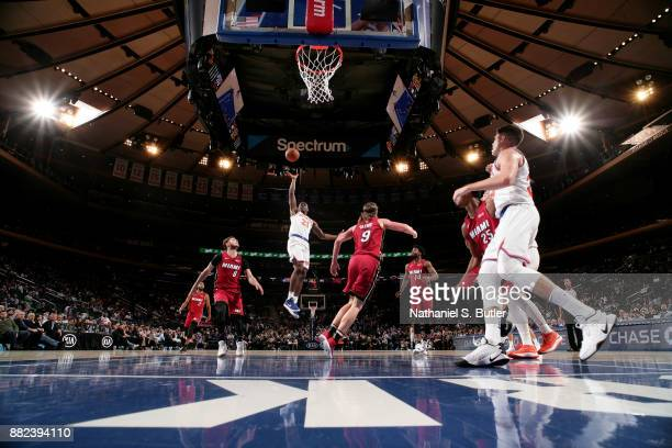 Damyean Dotson of the New York Knicks shoots the ball during the game against the Miami Heat on November 29 2017 at Madison Square Garden in New York...