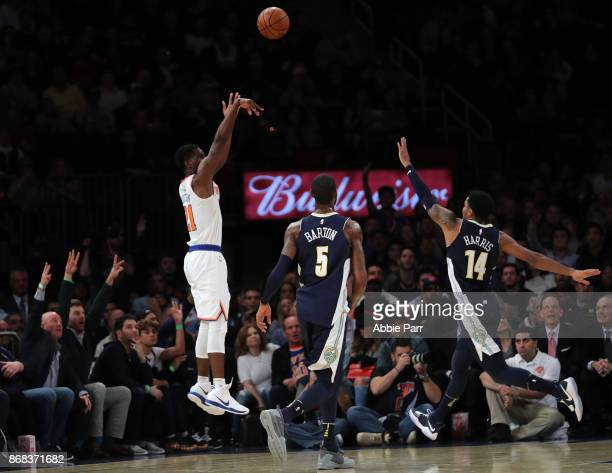Damyean Dotson of the New York Knicks takes a shot against Gary Harris of the Denver Nuggets in the first half during their game at Madison Square...