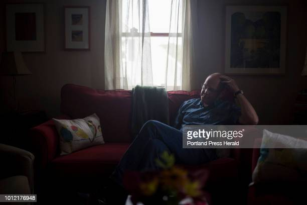 Dan Abbott in the living room of the home he shares in Portland with his wife the novelist Monica Wood The couple recently decide to talk publicly...