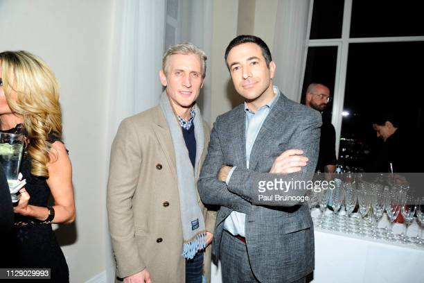 Dan Abrams and Ari Melber attend The Cinema Society With Synchrony Bank And FIJI Water Host The After Party For Marvel Studios' 'Captain Marvel' at...