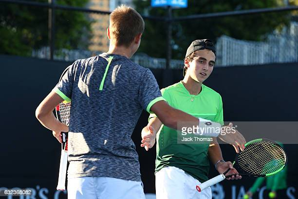 Dan Added of France and Matteo Martineau of France compete in their first round match against Simon Carr of Ireland and Max Stewart of Great Britain...
