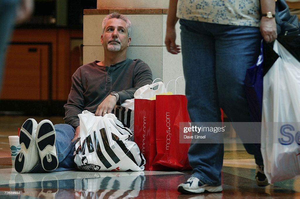 Dan Aldrich takes a break from shopping at the Baybrook Mall, November 24, 2006 in Friendswood, Texas. Alrich arrived at the mall at 4:30am and said, 'I'm just trying to keep up with my wife.' The Friday after Thanksgiving is counted on by retailers to be the busiest day of the year.