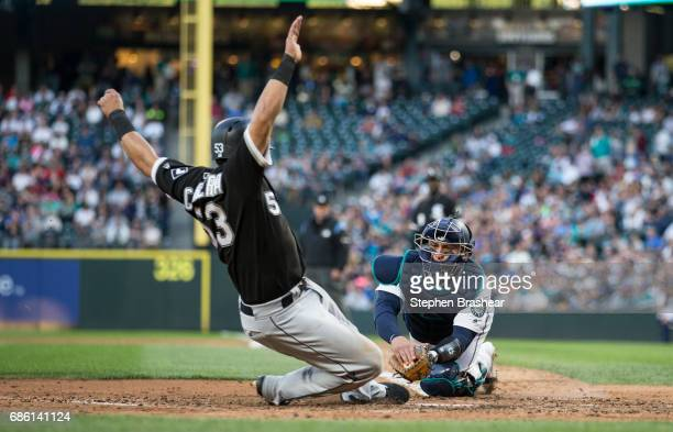Dan Altavilla of the Chicago White Sox slides safely into home plate before catcher Carlos Ruiz of the Seattle Mariners can apply a tag on a tworun...