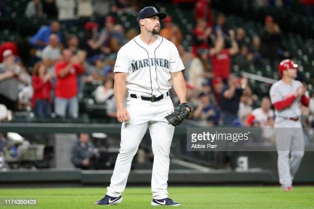 Dan Altavilla of the Seattle Mariners reacts after giving up a grand slam to Freddy Galvis of the Cincinnati Reds to give them a 7-5 lead in the...